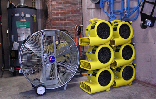 Fans used along with dehumidifiers were placed in storage once the building heat was turned on. Photo credit: Ian Culnane