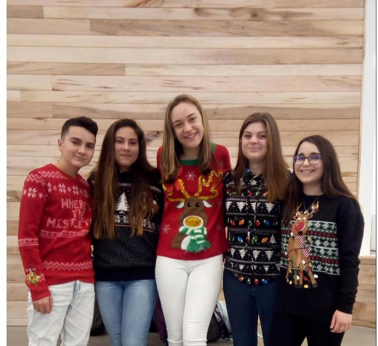 A+group+of+students+pose+for+a+picture+on+Ugly+Sweater+Day%2C+one+of+Greylock%27s+most+well-known+school+spirit+days.