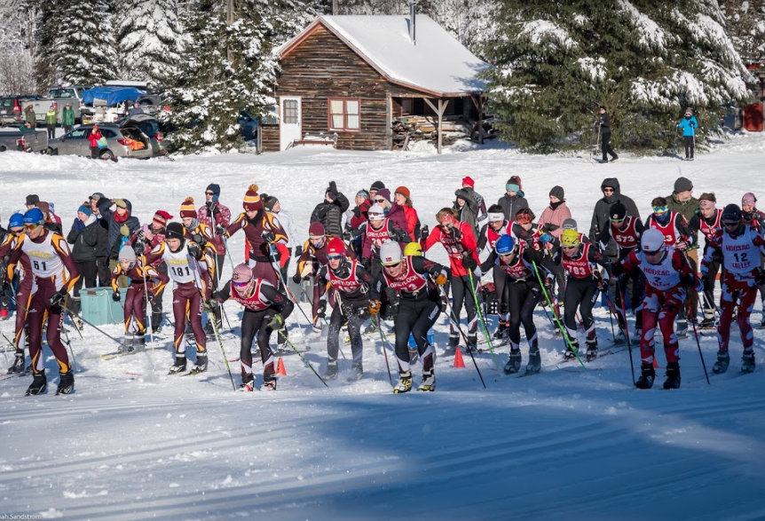 Greylock skiers launch out of a mass start in Saturday's league race.