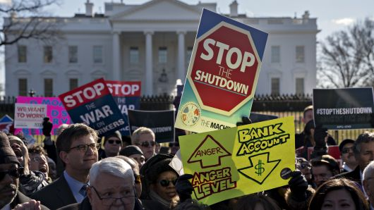 Demonstrators protest the federal government shutdown.
