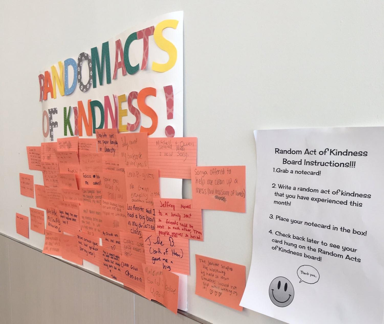 Peer Team's Random Acts of Kindness Board hangs in the cafeteria.