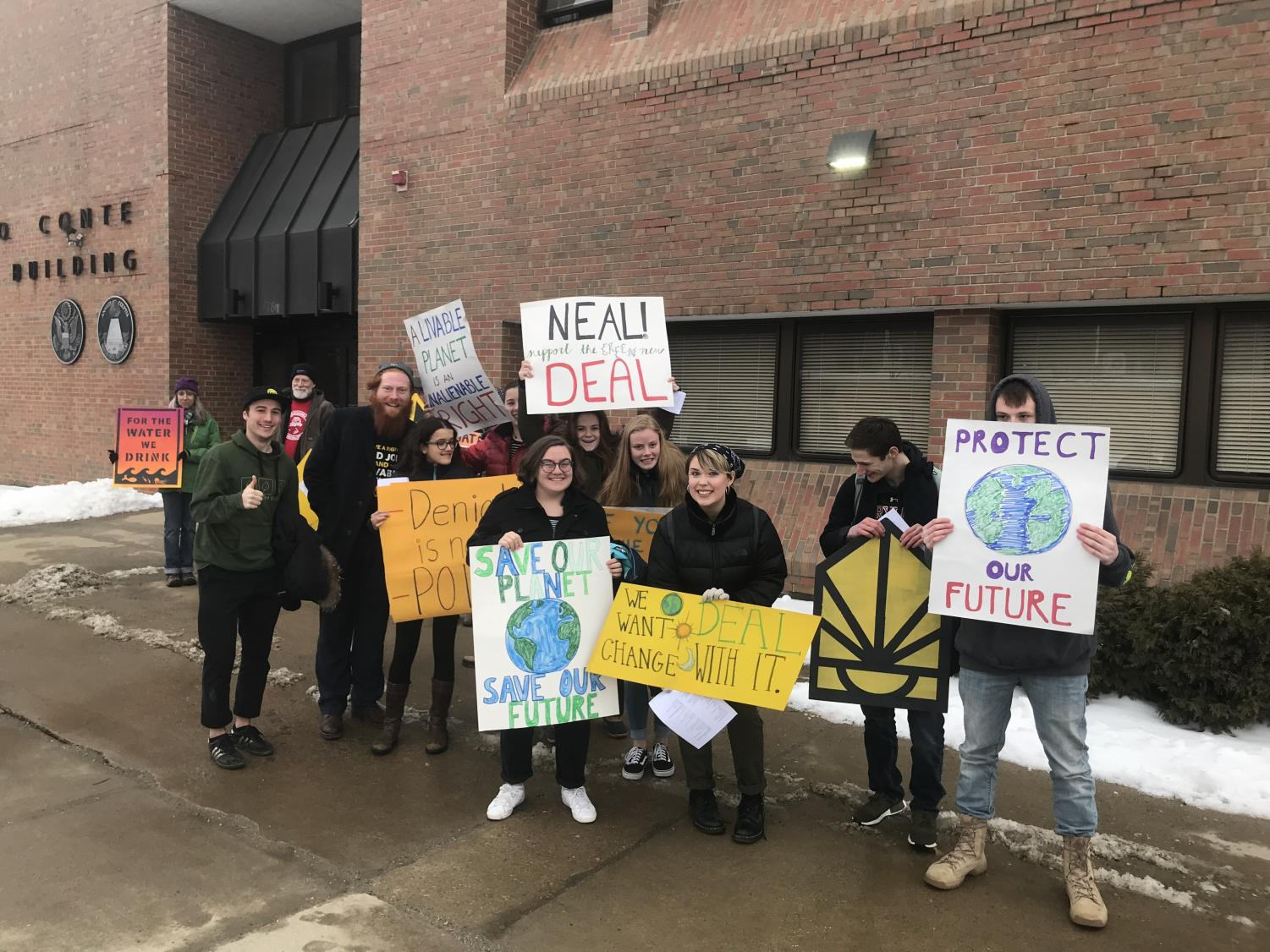 Greylock students hold signs outside of Richard Neal's Pittsfield office.