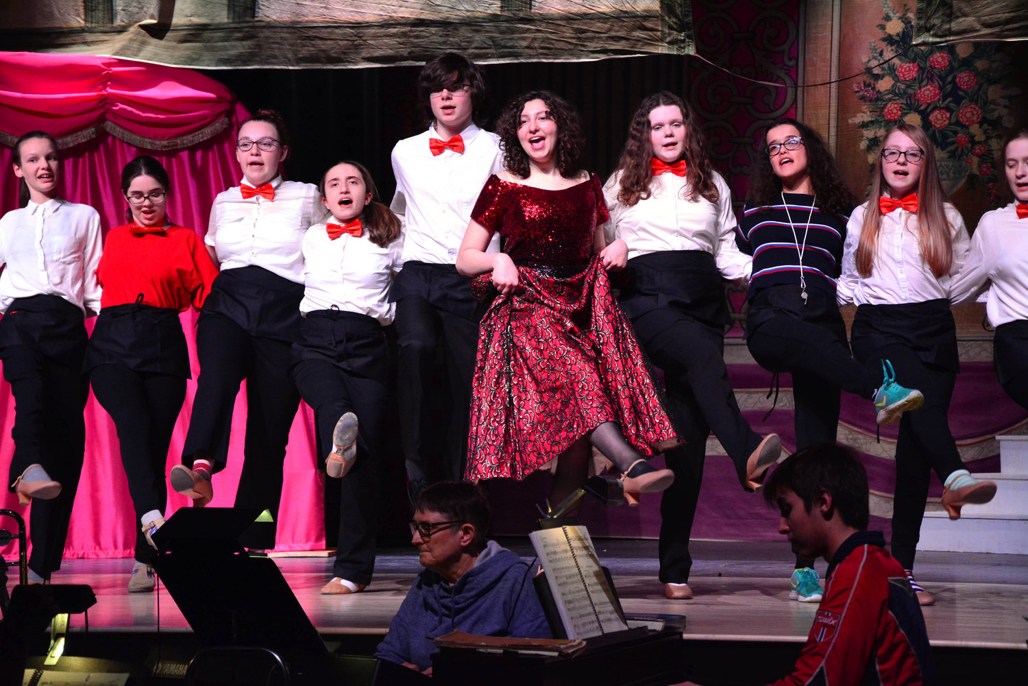 Weaver and ensemble members sing and dance in Hello, Dolly!