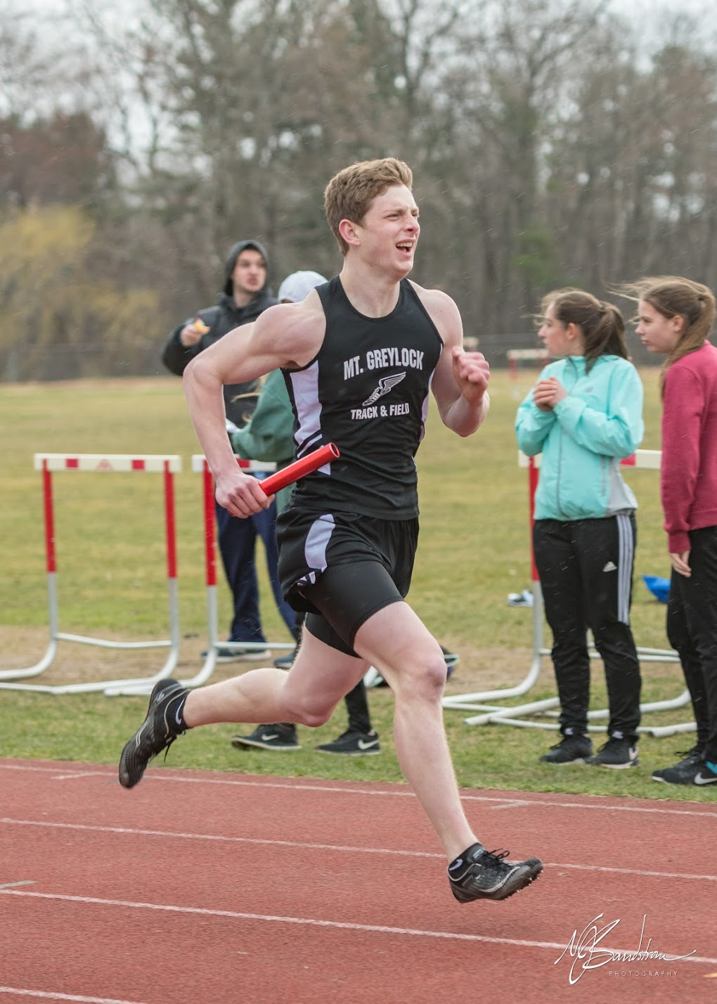 Senior Theo Sandstrom powers to the finish of his relay leg.